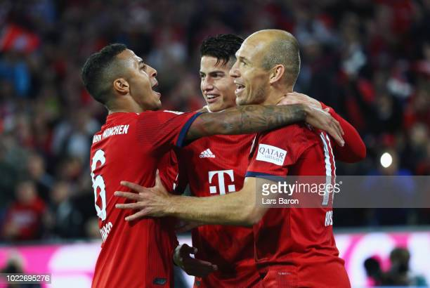Arjen Robben of Bayern Munich celebrates as he scores his team's third goal with Thiago Alcantara and James Rodriguez during the Bundesliga match...