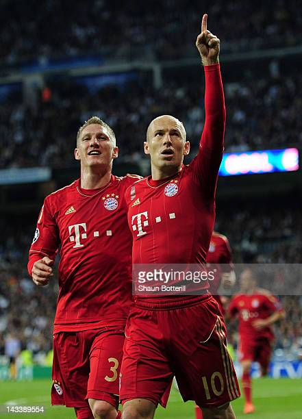 Arjen Robben of Bayern Munich celebrates scoring from the penalty spot with Bastian Schweinsteiger during the UEFA Champions League Semi Final second...