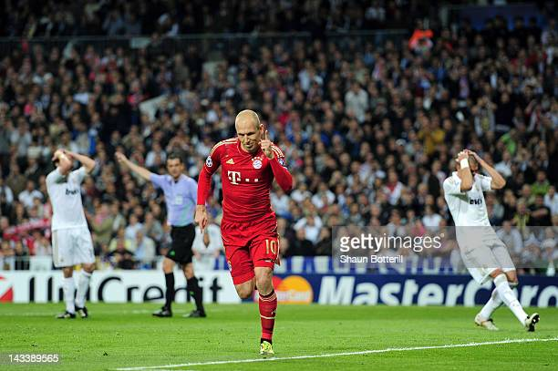 Arjen Robben of Bayern Munich celebrates scoring from the penalty spot during the UEFA Champions League Semi Final second leg between Real Madrid CF...