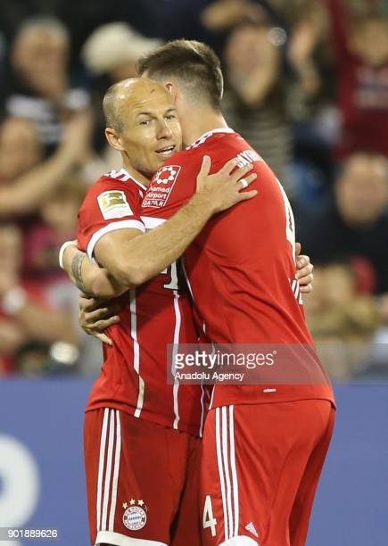 Arjen Robben of Bayern Munich celebrates with his teammate Niklas Sule after scoring during a friendly match between FC Bayern Munich and AlAhly at...
