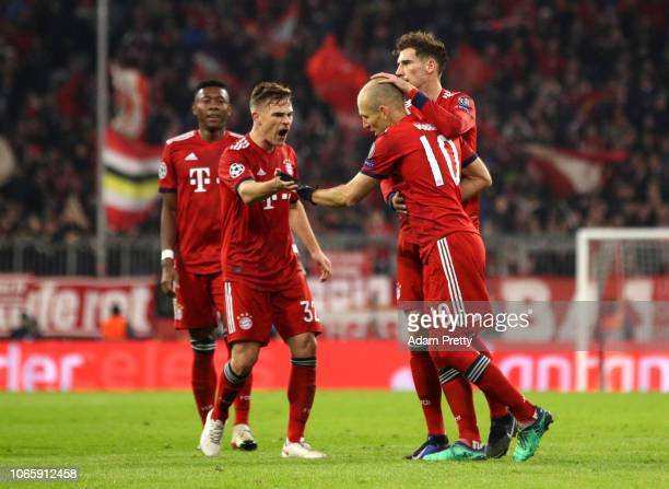 Arjen Robben of Bayern Munich celebrates with team mates after scoring their team's second goal during the UEFA Champions League Group E match...