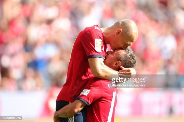Arjen Robben of Bayern Munich celebrates with teammate Rafinha after scoring his team's second goal during the Bundesliga match between FC Bayern...