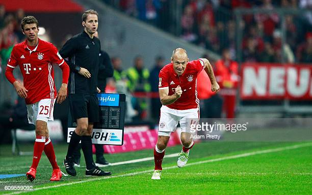 Arjen Robben of Bayern Munich comes on to substitute Thomas Mueller during the Bundesliga match between Bayern Muenchen and Hertha BSC at Allianz...