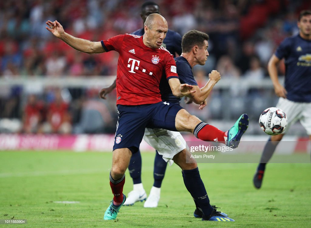 Arjen Robben of Bayern Munich is challenged by Ander Herrera of Manchester United during the Bayern Muenchen v Manchester United Friendly Match at Allianz Arena on August 5, 2018 in Munich, Germany.