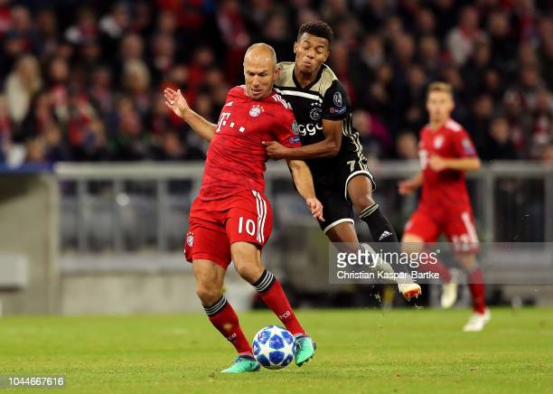 Arjen Robben of Bayern Munich is challenged by David Neres of Ajax during the Group E match of the UEFA Champions League between FC Bayern Muenchen...