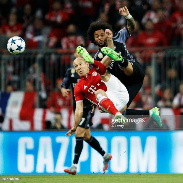 Arjen Robben of Bayern Munich is challenged by Marcello of Real Madrid during the UEFA Champions League Quarter Final first leg match between FC...