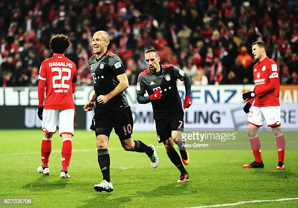 Arjen Robben of Bayern Munich is congratulated by Franck Ribery after scoring a goal during the Bundesliga match between 1 FSV Mainz 05 and Bayern...