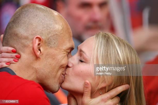 Arjen Robben of Bayern Munich kisses his wife Bernadien Eillert following the Bundesliga match between FC Bayern Muenchen and Eintracht Frankfurt at...