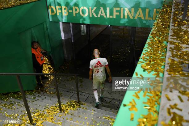 Arjen Robben of Bayern Munich leaves the pitch following his last game for Bayern Munich, and his team's victory inthe DFB Cup final between RB...