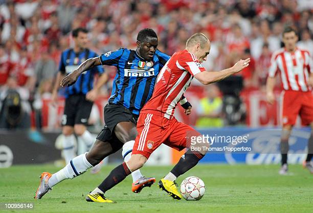 Arjen Robben of Bayern Munich moves away from Sulley Muntari of Inter Milan during the UEFA Champions League Final match between Bayern Munich and...