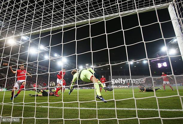 Arjen Robben of Bayern Munich scores a goal past Jonas Loessl of FSV Mainz 05 during the Bundesliga match between 1 FSV Mainz 05 and Bayern Muenchen...