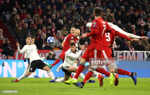 Arjen Robben of Bayern Munich scores his team's first goal during the UEFA Champions League Group E match between FC Bayern Muenchen and SL Benfica...