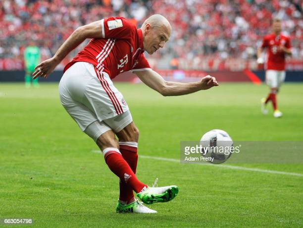 Arjen Robben of Bayern Munich takes a shot at goal during the Bundesliga match between Bayern Muenchen and FC Augsburg at Allianz Arena on April 1,...
