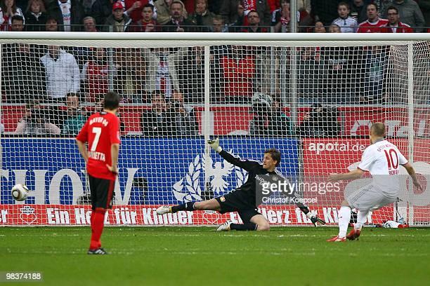 Arjen Robben of Bayern scores the first goal by penalty against Rene Adler of Leverkusen during the Bundesliga match between Bayer Leverkusen and FC...