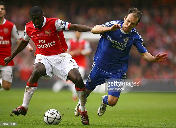 Arjen Robben of Chelsea battles for the ball with Kolo Toure of Arsenal during the Carling Cup Final match between Chelsea and Arsenal at the...