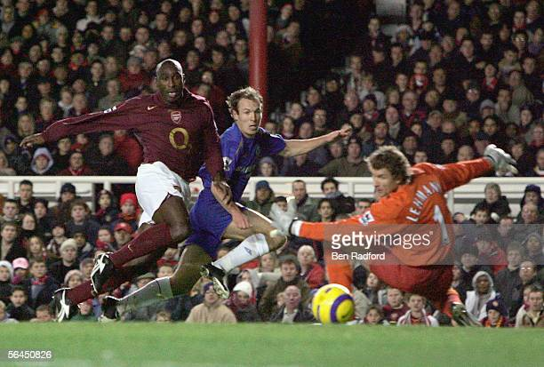 Arjen Robben of Chelsea slides the ball into the goal as Jens Lehmann and Sol Campbell of Arsenal can only look on during the Barclays Premiership...