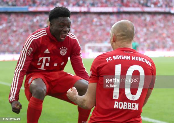 Arjen Robben of FC Bayern celebrates his goal with teammate Alphonso Davies during the Bundesliga match between FC Bayern Muenchen and Eintracht...