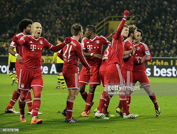 Arjen Robben of FC Bayern celebrates with teamates after Mario Gotze of FCBayern scores a goal during the Bundesliga match between FC Bayern and Bor...