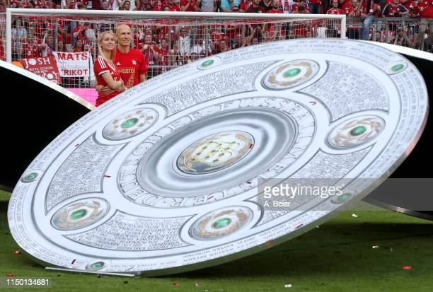 Arjen Robben of FC Bayern Muenchen and his wife Bernadien are pictured during the celebration of the team's German Championship title after the...