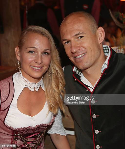 Arjen Robben of FC Bayern Muenchen and his wife Bernadien Eillert attend the Oktoberfest beer festival at Kaefer Wiesenschaenke tent at...