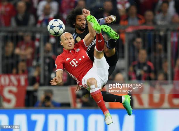 Arjen Robben of FC Bayern Muenchen and Marcelo of Real Madrid compete for the ball during the UEFA Champions League Quarter Final first leg match...