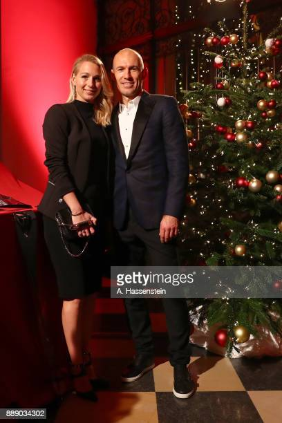 Arjen Robben of FC Bayern Muenchen arrives with his wife Bernadien Robben at Palais Lenbach for the FC Bayern Muenchen Christmas Party 2017 on...