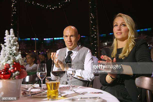 Arjen Robben of FC Bayern Muenchen attends with his wife Bernadien Robben the FC Bayern Muenchen Christmas Party at Alfons Schuhbeck`s...