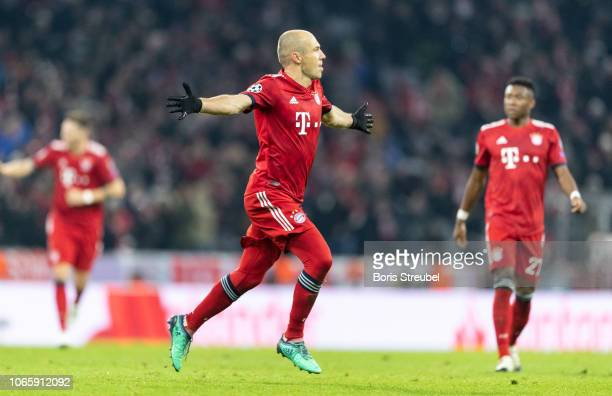 Arjen Robben of FC Bayern Muenchen celebrates after scoring his team's second goal during the Group E match of the UEFA Champions League between FC...