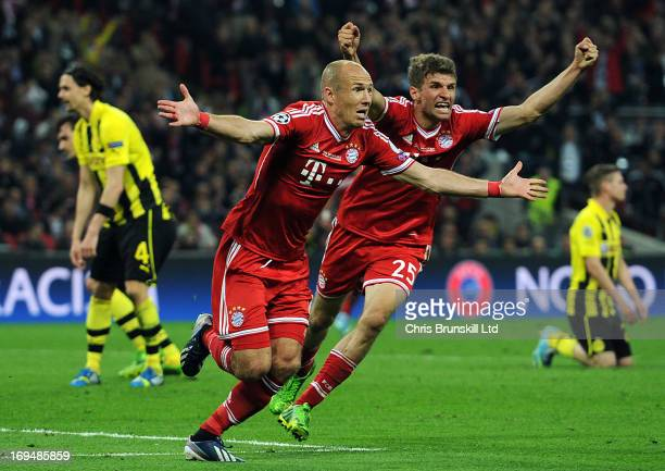 Arjen Robben of FC Bayern Muenchen celebrates scoring his side's second goal with team-mate Thomas Muller during the UEFA Champions League final...