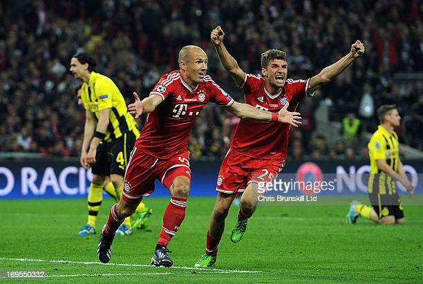 Arjen Robben of FC Bayern Muenchen celebrates scoring his side's second goal with teammate Thomas Muller during the UEFA Champions League final match...