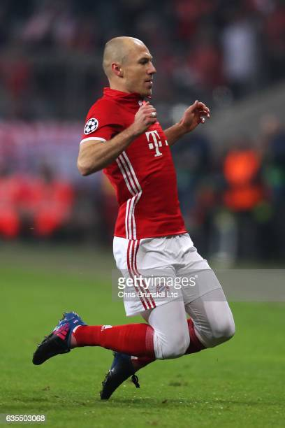 Arjen Robben of FC Bayern Muenchen celebrates scoring the opening goal during the UEFA Champions League Round of 16 first leg match between FC Bayern...