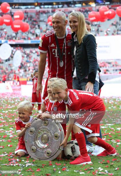 Arjen Robben of FC Bayern Muenchen celebrates with his wife Bernadien Robben and their children Luka Robben Lynn Robben and Kai Robben following the...