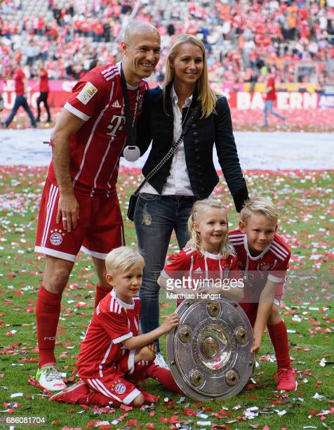 Arjen Robben of FC Bayern Muenchen celebrates with his wife Bernadien Robben and their children Luka Robben Lynn Robben and Kai Robben after winning...
