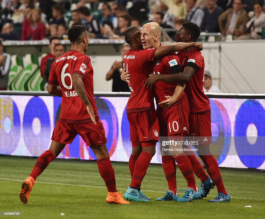 Arjen Robben of FC Bayern Muenchen celebrates with team mates as he scores the first goal during the DFL Supercup 2015 match between VfL Wolfsburg and FC Bayern Muenchen at Volkswagen Arena on August 1, 2015 in Wolfsburg, Germany.
