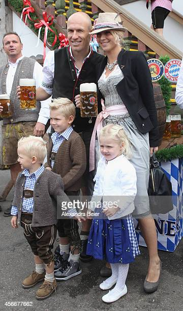 Arjen Robben of FC Bayern Muenchen his wife Bernadien and their children attend the Oktoberfest 2014 beer festival at Kaefers Wiesenschaenke at...