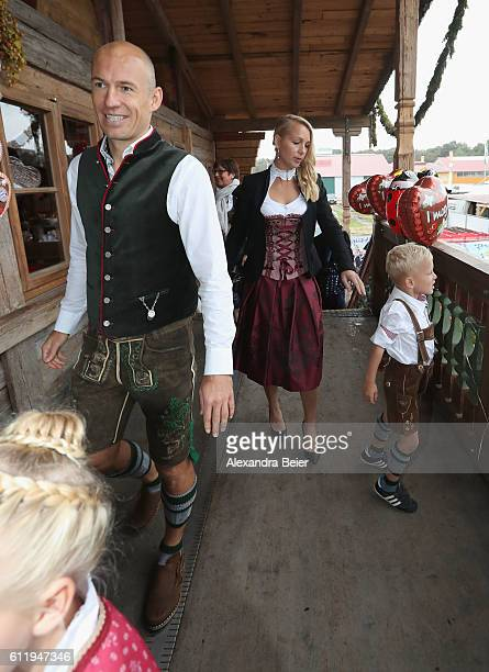 Arjen Robben of FC Bayern Muenchen his wife Bernadien Eillert and their children attend the Oktoberfest beer festival at Kaefer Wiesenschaenke tent...