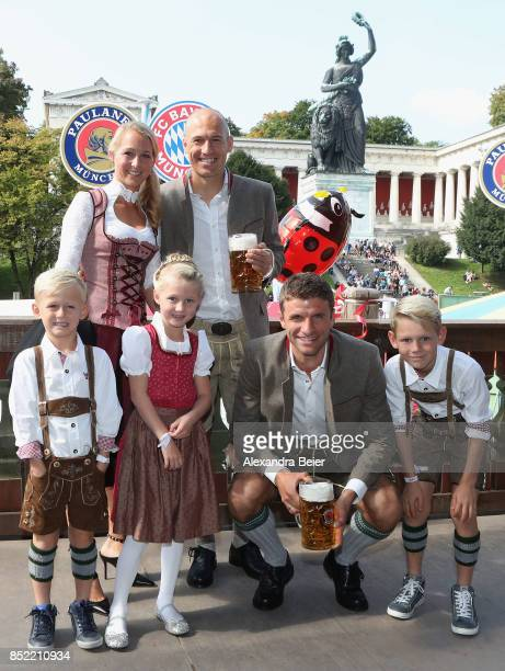 Arjen Robben of FC Bayern Muenchen his wife Bernadien Eillert their children and Thomas Mueller of FC Bayern Muenchen attend the Oktoberfest beer...
