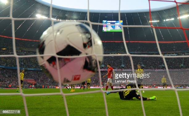 Arjen Robben of FC Bayern Muenchen scores his side's third goal against Roman Buerki of Borussia Dortmund during the Bundesliga match between Bayern...