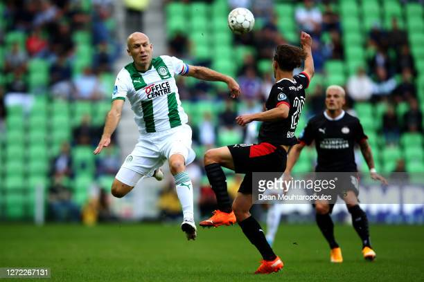 Arjen Robben of Football Club Groningen battles for the ball with Olivier Boscagli of PSV during the Dutch Eredivisie match between FC Groningen and...