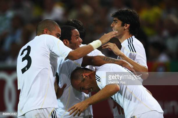 Arjen Robben of Madrid is celebrated by his team mates after scoring his team's second goal during a friendly match between Borussia Dortmund and...