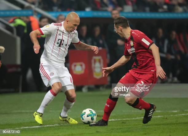 Arjen Robben of Muenchen and Dominik Kohr of Leverkusen battle for the ball during the Bundesliga match between Bayer 04 Leverkusen and FC Bayern...