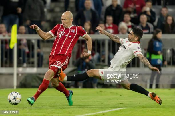 Arjen Robben of Muenchen and Ever Banega of Sevilla battle for the ball during the UEFA Champions League quarter final second leg match between...