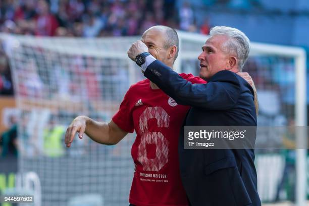 Arjen Robben of Muenchen and Head coach Jupp Heynckes of Muenchen gesture during the Bundesliga match between FC Augsburg and FC Bayern Muenchen at...