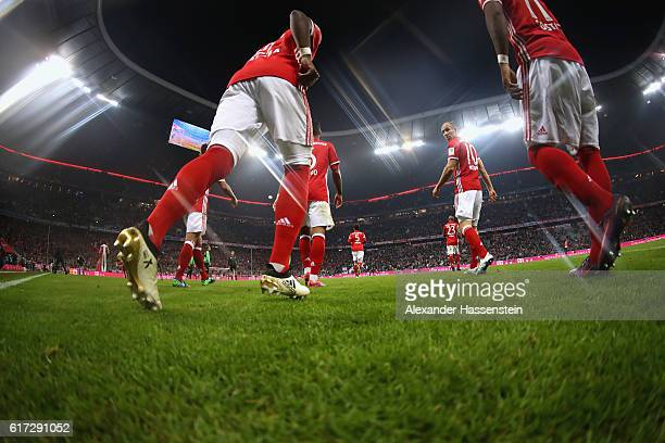 Arjen Robben of Muenchen and her team mates enter the field of play for the Bundesliga match between Bayern Muenchen and Borussia Moenchengladbach at...