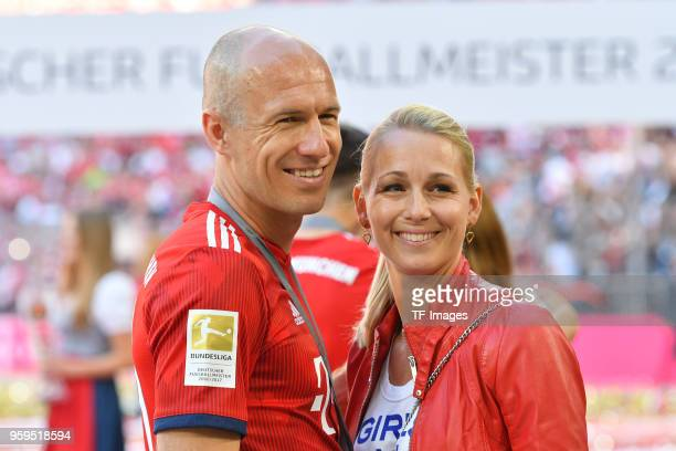 Arjen Robben of Muenchen and his wife Bernadien laugh after the Bundesliga match between FC Bayern Muenchen and VfB Stuttgart at Allianz Arena on May...