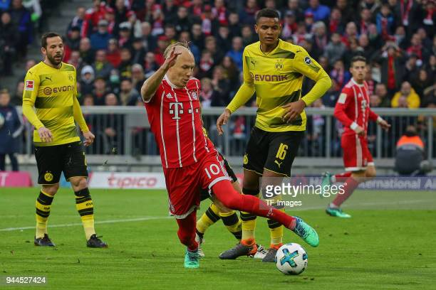 Arjen Robben of Muenchen and Manuel Akanji of Dortmund battle for the ball during the Bundesliga match between Bayern Muenchen and Borussia Dortmund...
