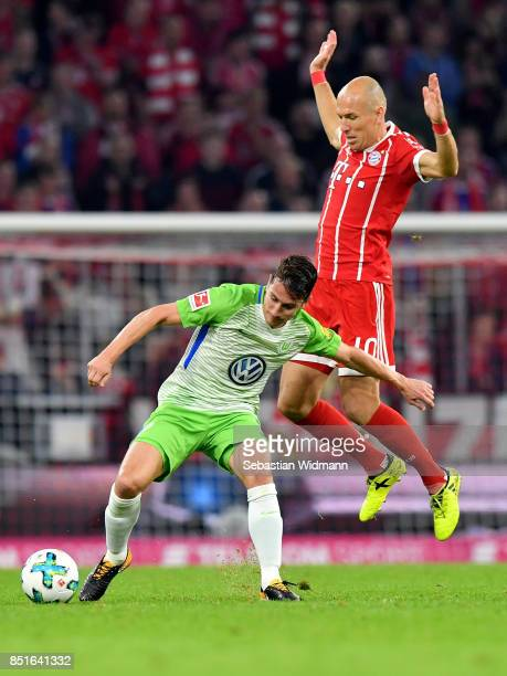Arjen Robben of Muenchen and Paul Verhaegh of Wolfsburg battle for the ball during the Bundesliga match between FC Bayern Muenchen and VfL Wolfsburg...
