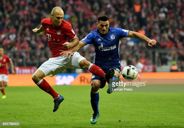 Arjen Robben of Muenchen and Sead Kolasinac of Schalke battle for the ball during the Bundesliga match between Bayern Muenchen and FC Schalke 04 at...