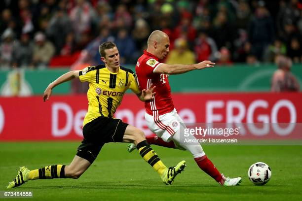 Arjen Robben of Muenchen and Sven Bender of Dortmund battle for the ball during the DFB Cup semi final match between FC Bayern Muenchen and Borussia...