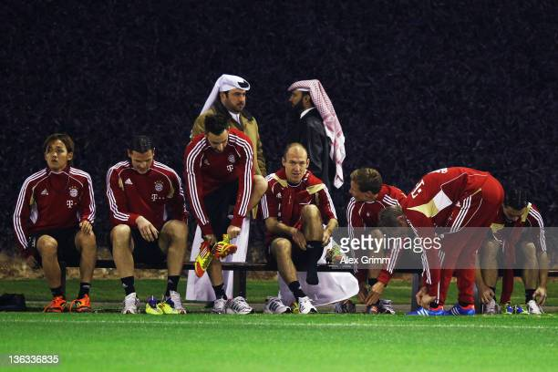 Arjen Robben of Muenchen and team mates prepare for a training session of Bayern Muenchen at the ASPIRE Academy for Sports Excellence on January 2...